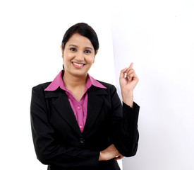 Young happy business woman showing blank signboard, isolated on
