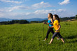 Nordic walking - active people working out outdoor