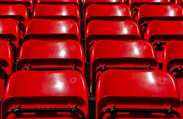 Red seats on football stadium
