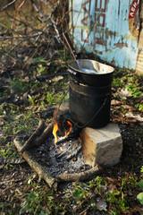Metal bucket on fire, outdoors