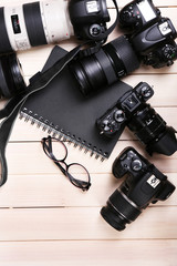 Modern cameras with glasses and notebook