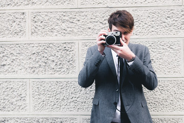 Business man holding a vintage camera - horizontal