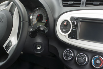 Car dashboard with instruments and steering wheel