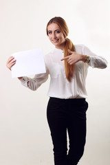 Portrait of smiling business woman with finger shows the documen