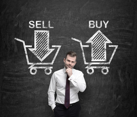 Businessman is thinking about the choice 'sell or buy', arrows