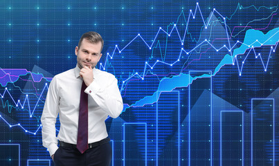 Trader is standing in front of the forex graph.
