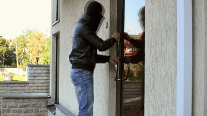 Burglar trying to open office door, but failed.