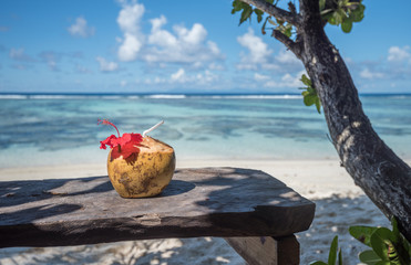 Pina colada in coconut on the tropical beach, Seychelles