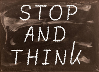 The phrase Stop and Think written on a blackboard as a reminder