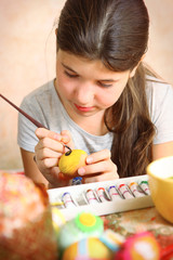 preteen beautiful girl paint boiled eggs for easter holiday part