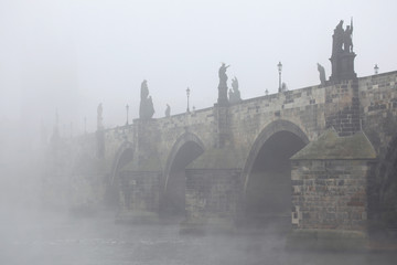 Morning fog over the Charles Bridge in Prague.