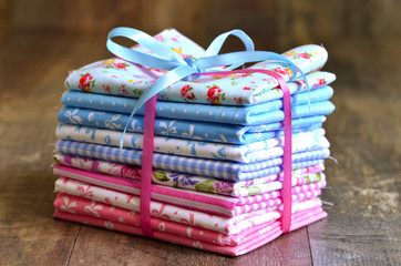 Pile of colorful folded textile.