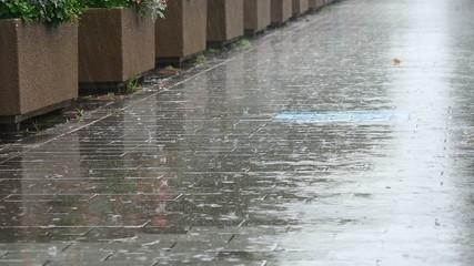 Slowmotion raindrops on the pavement