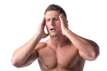 Muscular handsome man holding his head with for headache
