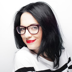young emotional  brunette woman wearing glasses