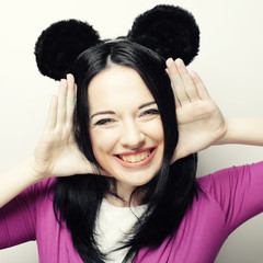 Surprised young woman with mouse ears