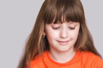 Girl smiling eyes lowered down