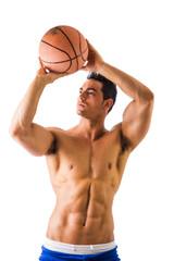 Muscular shirtless male model throwing basketball ball