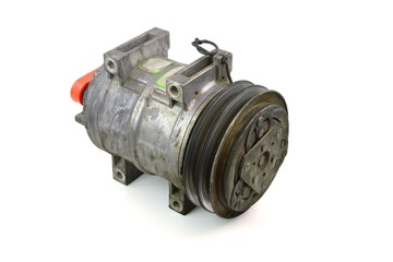 Automotive air conditioning compressor old on a white