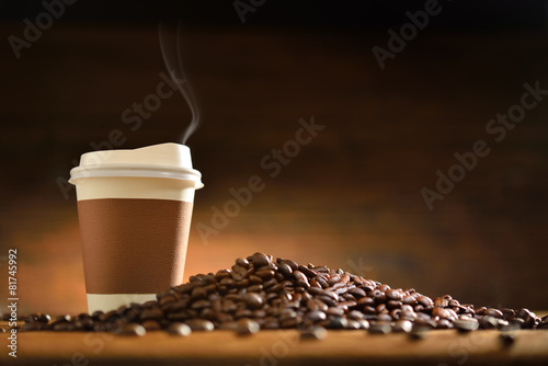 Fotobehang Cafe Paper cup of coffee and coffee beans on old wooden background