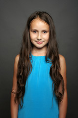 Beautiful child poses for the camera in studio.Isolated portrait