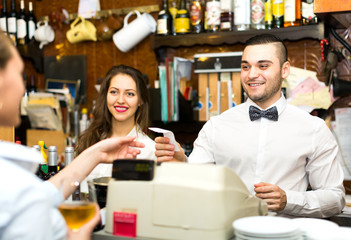 Mixed gender staff in bar