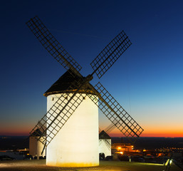 windmills at field in evening