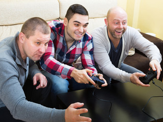 Men relaxing with video game