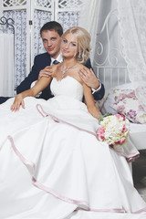 The bride and groom sit