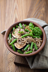 Buckwheat soba noodles with aubergines, beans and sesame