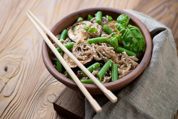 Soba noodles with aubergine slices, beans and sesame seeds