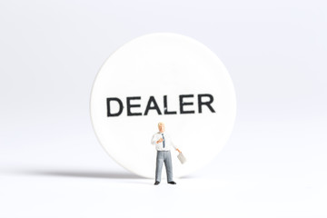 Businessman in front of a dealer sign