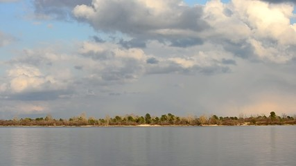 Timelapse of cloudscape with moving clouds over Dnieper river