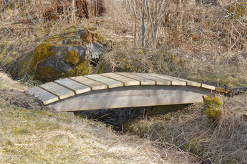 small wooden curved bridge
