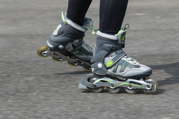 Dynamic closeup view of a woman on inline skates