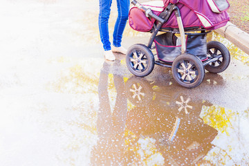 mother at outdoor shakes a baby carriage