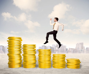 Successful business man jumping up on gold coin money