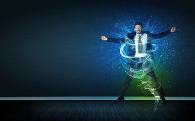 Talented cheerful businessman jumping with glowing energy lines