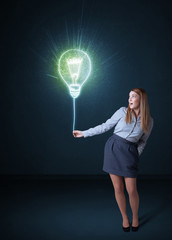 Businesswoman with an idea bulb
