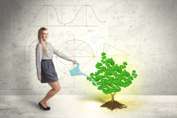 Business woman watering a growing green dollar sign tree
