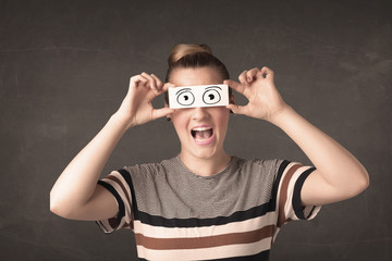 Funny woman looking with hand drawn paper eyes