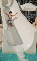 The boy is have fun in the aqua park
