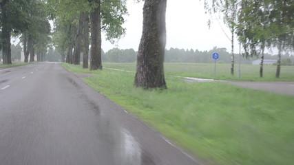 rain fall on car automobile windscreen drive on road