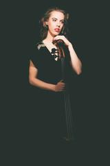 Elegant young female cellist