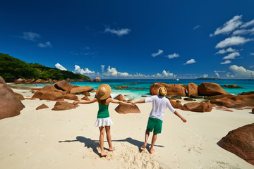 Couple in green having fun on a beach at Seychelles