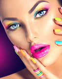 Fototapety Beauty girl face with vivid makeup and colorful nail polish