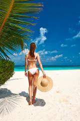 Woman in bikini on a beach at Maldives