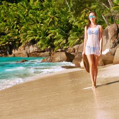 Woman in bikini on beach at Seychelles