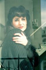 Melancholic Girl at the Window.