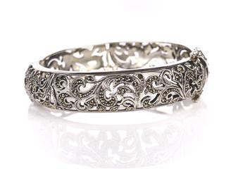 Silver bracelet on white a background